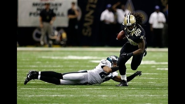 Vick takes beating, Eagles lose to Saints 28-13