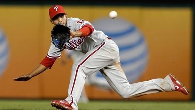 Phillies lose run on reversal, fall to Rangers 3-2