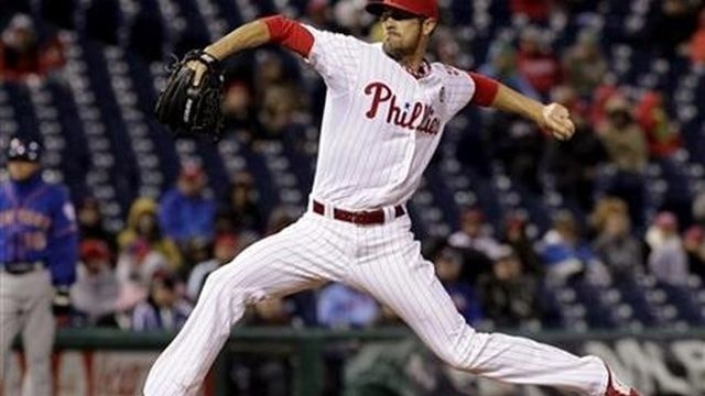 Hamels all wet, Phillies lose to Mets 6-1 in rain