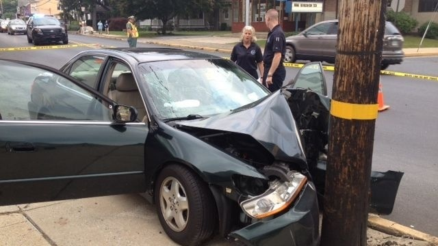 Man dies after car hits utility pole