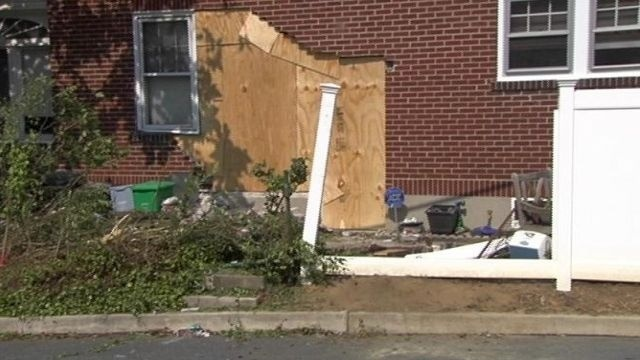 Woman trapped after vehicle hits house in Allentown