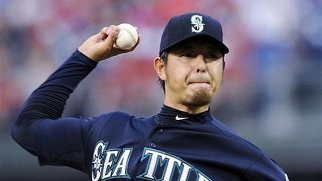 Iwakuma fans season-high 11, Mariners top Phillies