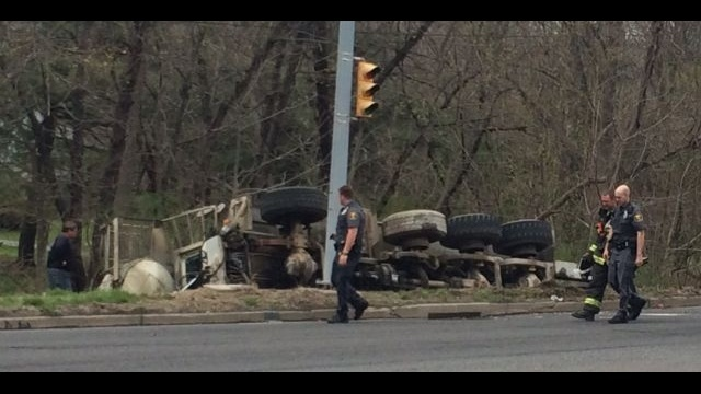 Truck loaded with concrete flips off Route 378