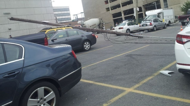 Excavator brings down power line and poles in Center City