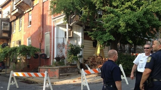 Building crumbles in Reading; owner placed in handcuffs