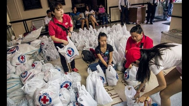 Local Red Cross helping locate people after typhoon