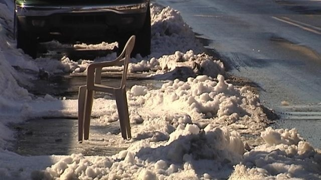 Save your parking space, lose your lawn chairs