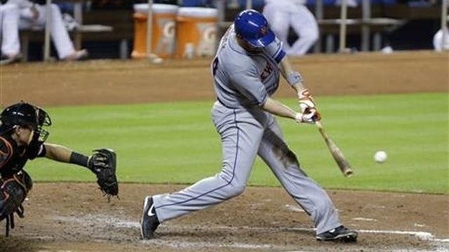 John Buck's single in the 10th inning leads Mets past Marlins