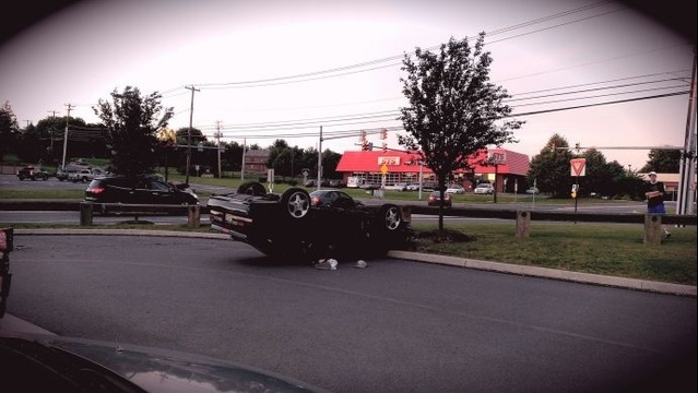 Car flips over in grocery store parking lot