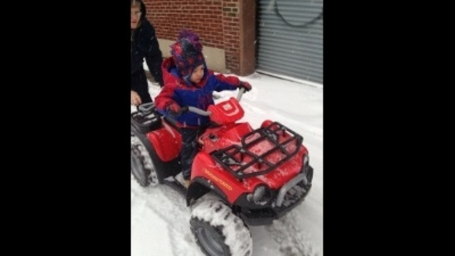 3yr old avion Roberts going for a ride in the snow_24049048