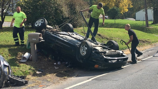 Overturned car takes out mailboxes on Route 61