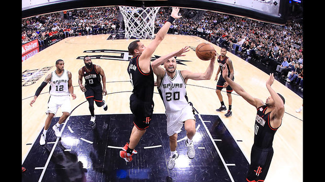 Spurs squeeze by Rockets in OT